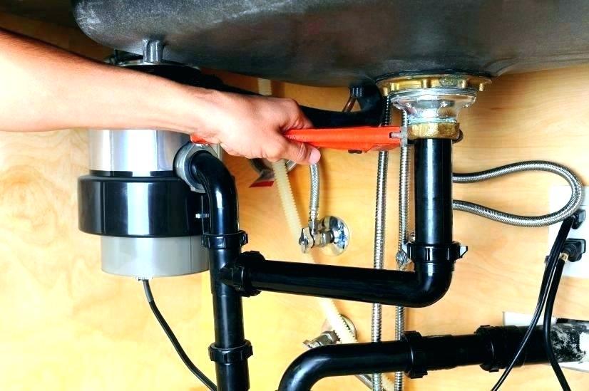 Plumber repairs disposer Greenville Plumbing Pros