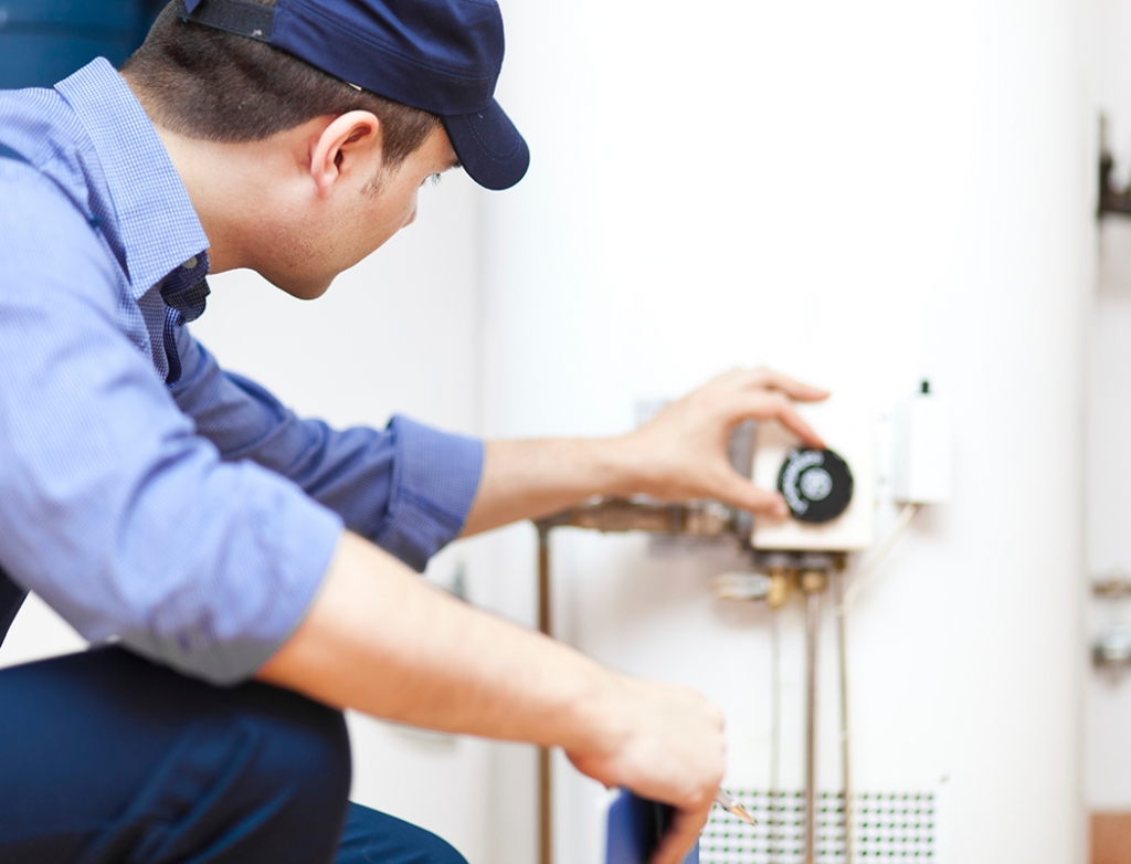 Plumber checks water heater Greenville Plumbing Pros